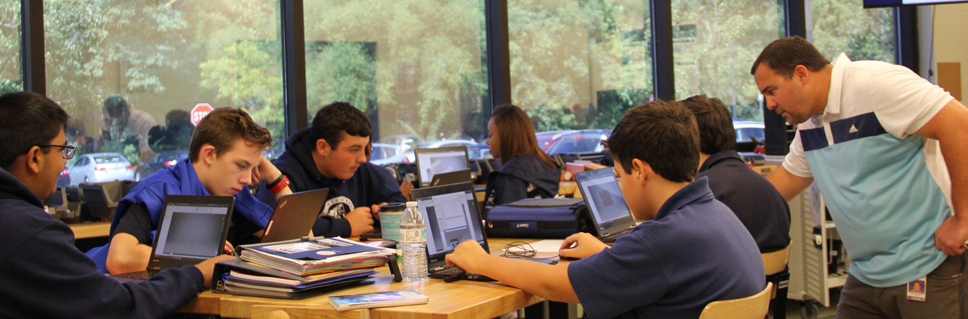 High school students working in one of their technology classes.